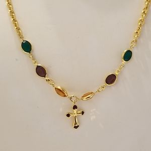 Avon Jewel tone accents on golden cross chain